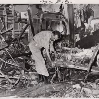 Police Lieutenant Examines Rubble